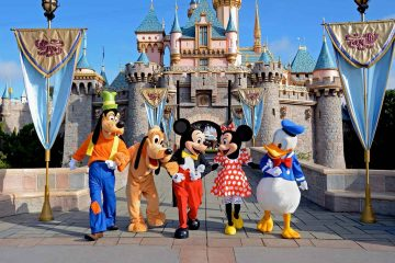 Disney characters in front of the Disneyland castle