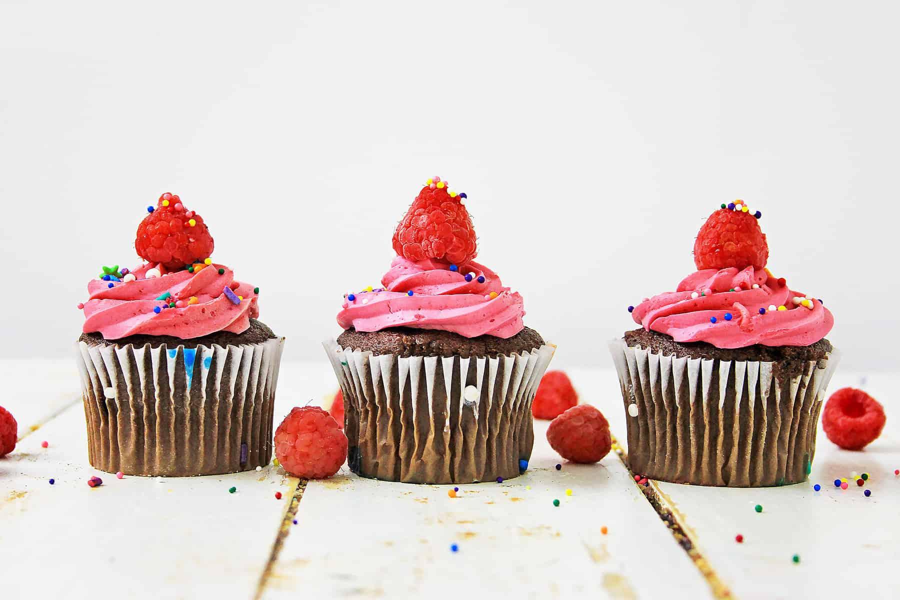 Three raspberry cupcakes