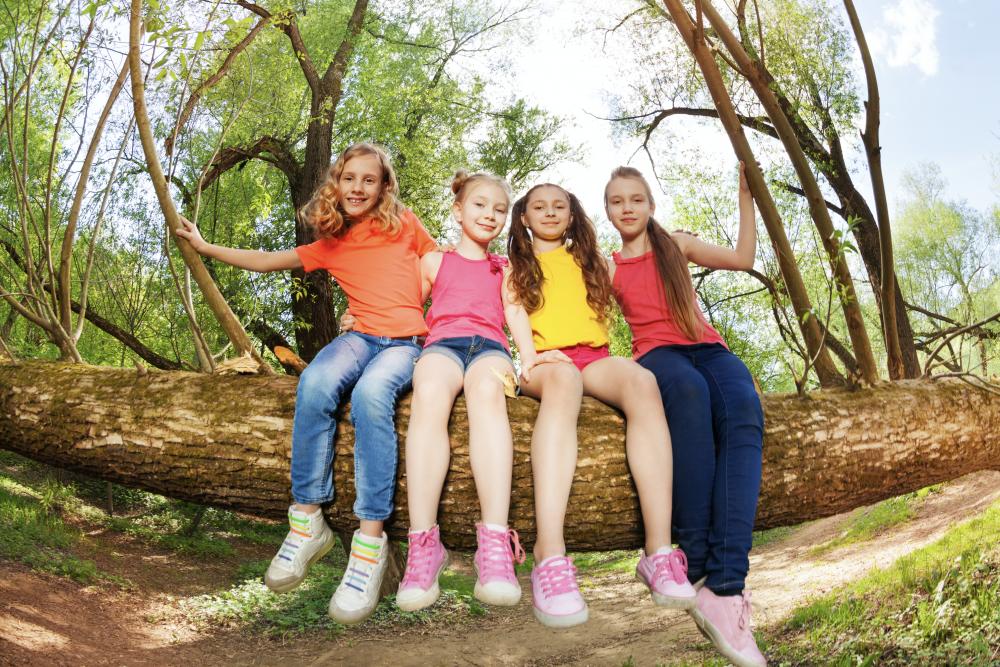 girls sitting on a tree